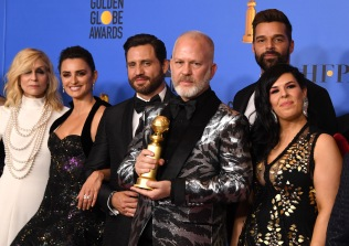 "Best Limited Series or Motion Picture Made for Television ""The Assassination of Gianni Versace"" winners producer Ryan Murphy (3rd from R) and actors Penelope Cruz, Edgar Ramirez, Ricky Martin pose with the trophy during the 76th annual Golden Globe Awards on January 6, 2019, at the Beverly Hilton hotel in Beverly Hills, California. (Photo by Mark RALSTON / AFP) (Photo credit should read MARK RALSTON/AFP/Getty Images)"